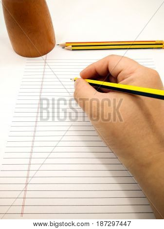Writing with Pencil on a piece of Blank Paper
