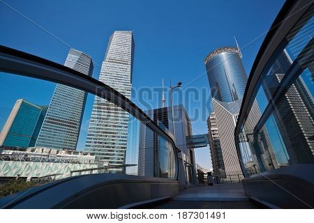 City streetscape office buildings backgrounds with lift escalator in shanghai Lujiazui