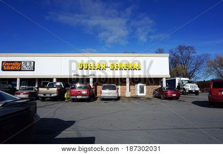 BAY VIEW, MICHIGAN / UNITED STATES - NOVEMBER 26, 2016: One may purchase household goods and general merchandise at the Dollar General, in a Bay View strip mall.