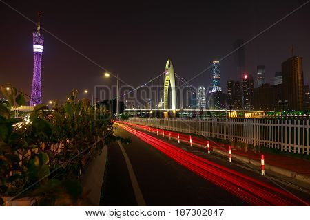 Empty road textured floor at car light trail with  landmark architecture backgrounds of night scene