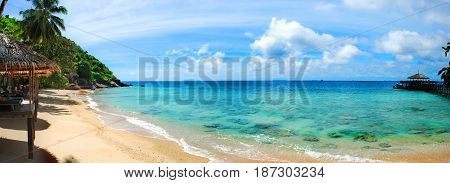 Panoramic of golden sand beach and turquoise waters of Tioman Island Malaysia