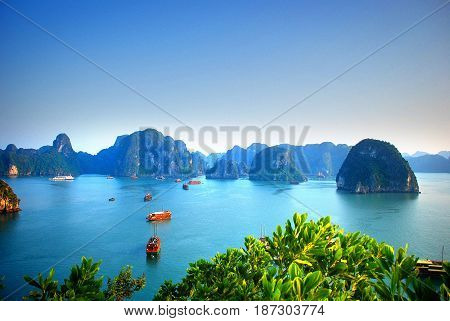 Aerial view of traditional junks sailing the blue waters of Halong Bay Vietnam