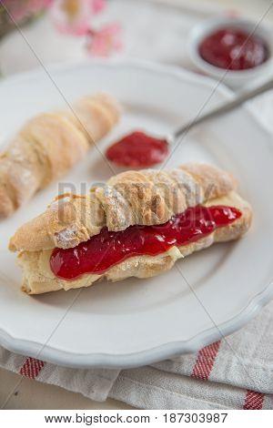 Fresh tasty homemade croissants with home made raspberries jam
