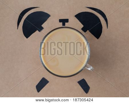 Coffee break concept. breakfast time concept. Coffe cup in shape of alarm clock. top view