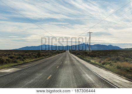Remote Highway In Desert Landscape
