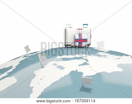 Luggage With Flag Of Faroe Islands. Three Bags On Top Of Globe