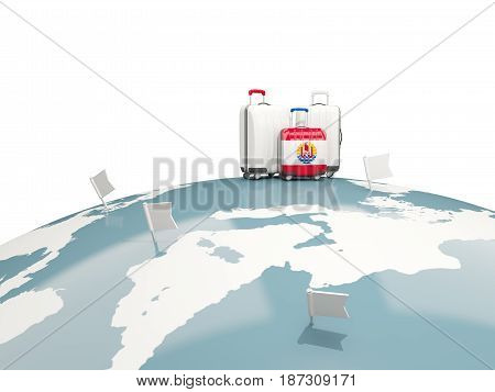 Luggage With Flag Of French Polynesia. Three Bags On Top Of Globe