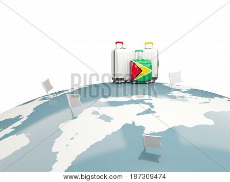 Luggage With Flag Of Guyana. Three Bags On Top Of Globe