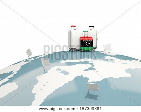 Luggage With Flag Of Libya. Three Bags On Top Of Globe