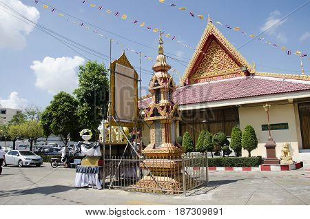 Thai people walk to chedi and ubosot of Wat Wachirathammasatit or wat thung satit temple for pray and respect buddha statue on February 19 2017 in Bangkok Thailand