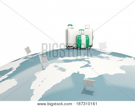 Luggage With Flag Of Nigeria. Three Bags On Top Of Globe