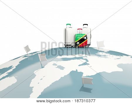 Luggage With Flag Of Saint Kitts And Nevis. Three Bags On Top Of Globe