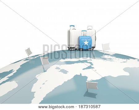Luggage With Flag Of Somalia. Three Bags On Top Of Globe