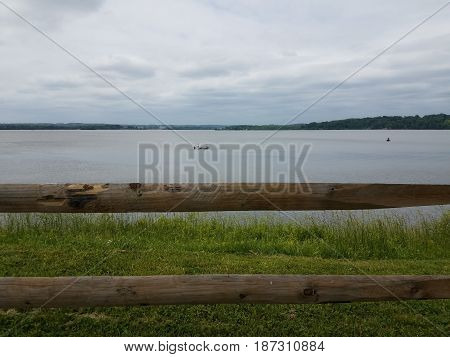 Potomac river, green grass, and a wood fence