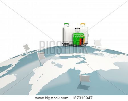 Luggage With Flag Of Zambia. Three Bags On Top Of Globe