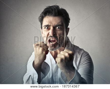 Angry man showing his fists