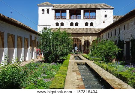 General view of The Generalife courtyard with its famous fountain and garden. Alhambra de Granada complex Spain