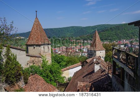 Unnamed Towers, Part Of Sighisoara Fortress And Medieval Houses Of Old Town. Transylvania, Romania