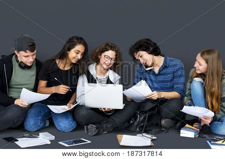 Group of Diverse High School Students Reading Text Book Tutorial