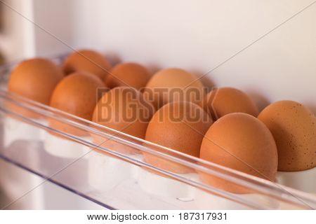 Packing eggs in a cardboard box. Eggs in the fridge.