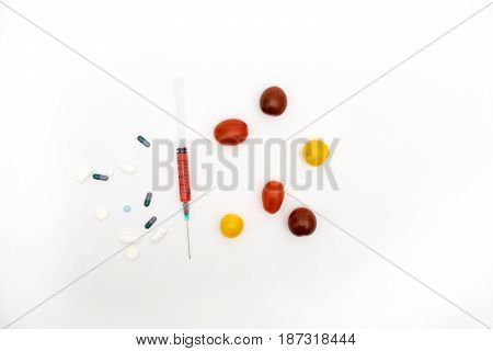 Gmo Concept On White Background With  Syringes, Pills  And Tomatoes.