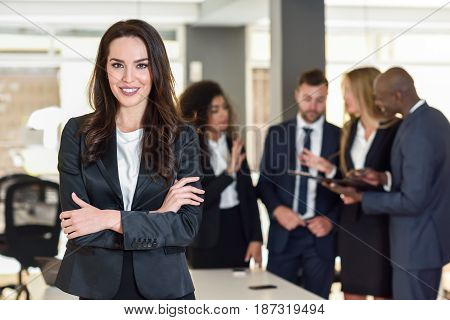 Businesswoman Leader In Modern Office With Businesspeople Working At Background