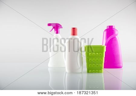 Spring cleanup theme. Variety of  house cleaning products on white table and background.