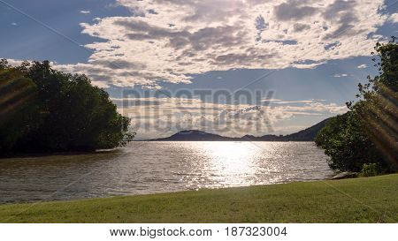 Landscape of green nature park with lake in sunny day and white cloud. Relax time.