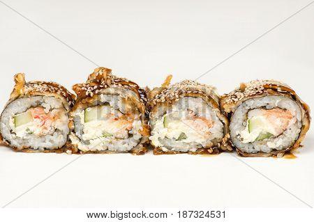 four beautiful sushi roll with salmon closeup