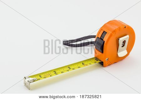 Tape measure with orange housing isolated on white background - Hardware tools object