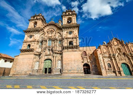 Cusco Peru - Plaza de Armas and Church of the Society of Jesus (spanish: Iglesia de la Compania de Jesus)