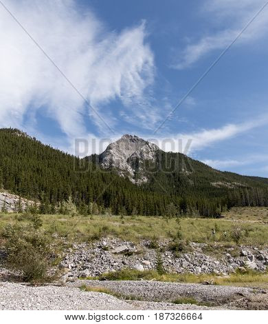 Clouds swirling over the peaks of mountains in Kananaskis country.