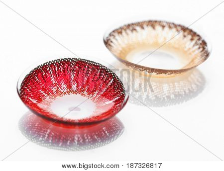Color contact lenses on white background