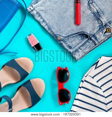 Set of female summer clothing - marine t shirt, denim shorts, sandals, sunglasses, purse, make up products