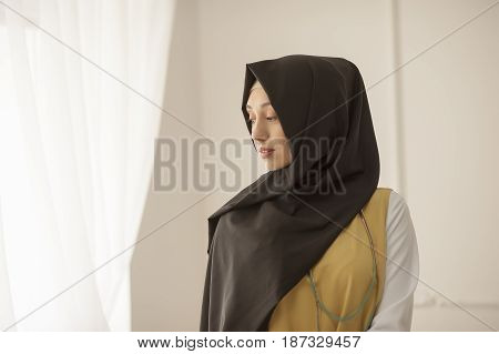 Portrait of a modest Muslim woman on a light background Russia