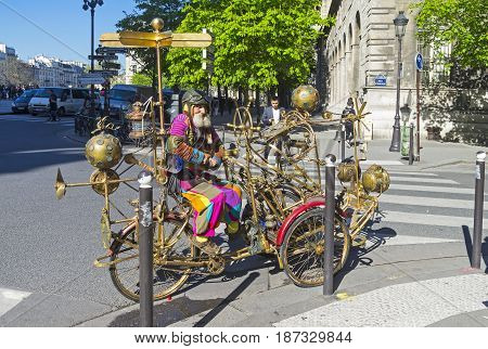 PARIS FRANCE - APRIL 2 2017: Attraction for tourists: a fantastic steampunk car and its pilot. A sunny day in early April. Paris France.