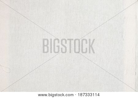 Close up texture of white cloth material. Fabric surface with linen pattern. Cotton textile background.