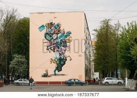 Gomel, Belarus - April 29, 2017: Mural by the Belarusian street artist Eugene Mutus covers a wall of residential house in Vetkovskaya street.