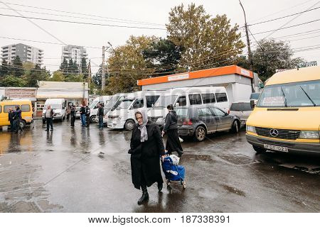 Tbilisi, Georgia - October 24, 2016: Woman Walks Near Urban Taxis Minibuses Are On The Station Didube In Tbilisi, Georgia.
