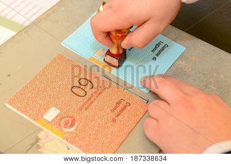 Hand  Validating A Voting Ballot At The Municipal Election
