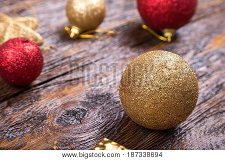 bright Christmas toy on a wooden background. Christmas and New Year Christmas tree decoration.