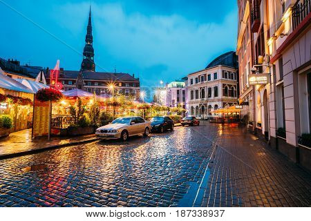 Riga, Latvia - July 3, 2016: Sedan Car BMW 5 Series E39 Parking Near Open Air Leisure Venue Recreation Center Egle In Evening Or Night Illumination In Old Town On Kalku Street