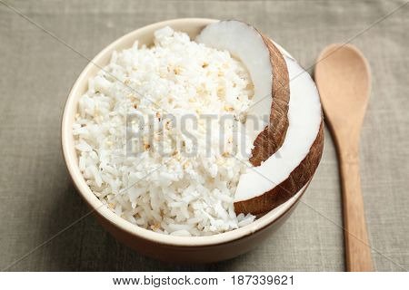 Bowl with coconut rice on table