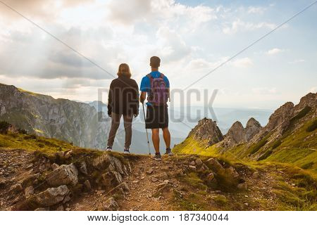 sporty couple hikers on top of mountain, Tatry