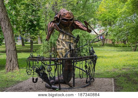 Donetsk Ukraine - May 09 2017: Iron statue of a beetle near an anvil in a park of forged figures