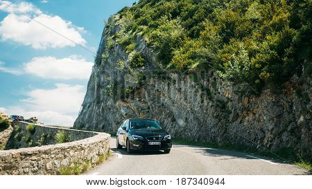 Verdon, France - June 29, 2015: Black colour Seat Leon 5-door car on background of French mountain nature landscape. The SEAT Leon is a hatchback small family car built since October 1998.