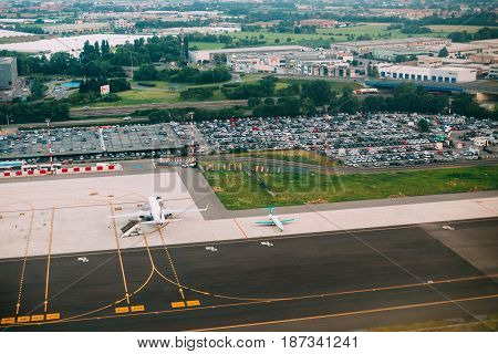 Bergamo, Italy - July 01, 2015: Aerial View Of Runway Of Orio Al Serio International Airport. Il Caravaggio International Airport, Is An International Airport Located In 3.7 Km Southeast Of Bergamo