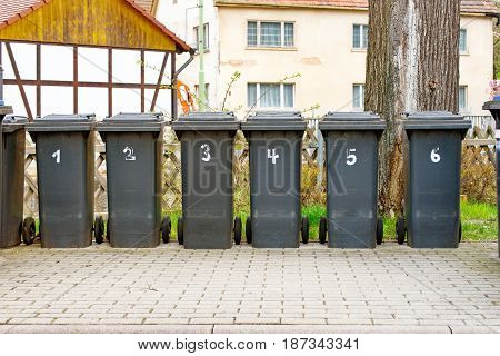 Some Numbered garbage cans for household waste