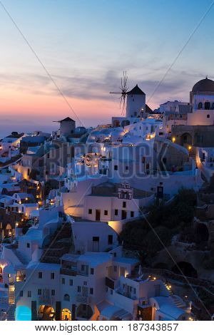 lights of Oia village at blue night, Santorini island, Greece