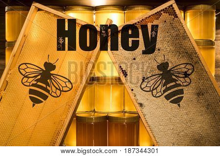 Golden yellow honey glass jar on wooden board Closeup Copy space comp frame empty and filled with bee logo with textspace